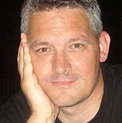A portrait of Neil White